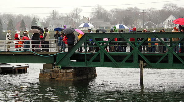 Hundreds of children lined up at the public dock to meet Santa, who arrived in Rockland by boat Friday morning. (Bangor Daily News/Heather Steeves)