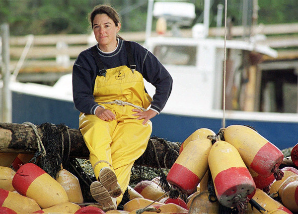 FILE - In this May 1999 file photo, swordfish boat captain Linda Greenlaw poses on Isle Au Haut, Maine. To improve sales, seafood sellers are attaching the name of celebrity fishermen, such as Linda Greenlaw, to help move their product.  Greenlaw is the Maine boat skipper featured on the Discovery Channel reality show, &quotSwords: Life on the Line&quot (AP Photo/Robert F. Bukaty, File)