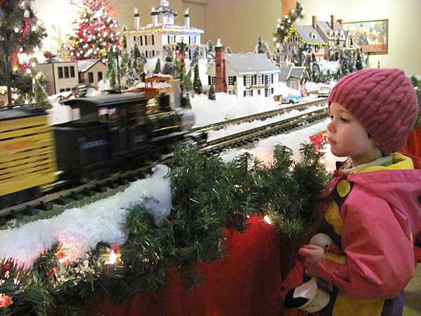 Miranda Yarosis, 3, of Rockland gazes intently at a passing model train Saturday, Nov. 27, 2010, at the Rockland Farnsworth Art Museum's &quotShare the Wonder&quot exhibit, which will be on display through Jan. 2. (Bangor Daily News/Christopher Cousins)