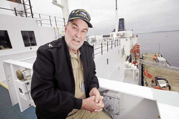 Capt. Larry Wade poses for a photo on the wing of the bridge aboard the Maine Maritime Academy training vessel State of Maine as it is docked in Castine Harbor on Monday, November 15, 2010. Wade joined MMA as skipper of the training vessel in 1996 and has been on 15 training cruises stopping at ports around the world. (Bangor Daily News/Kevin Bennett)