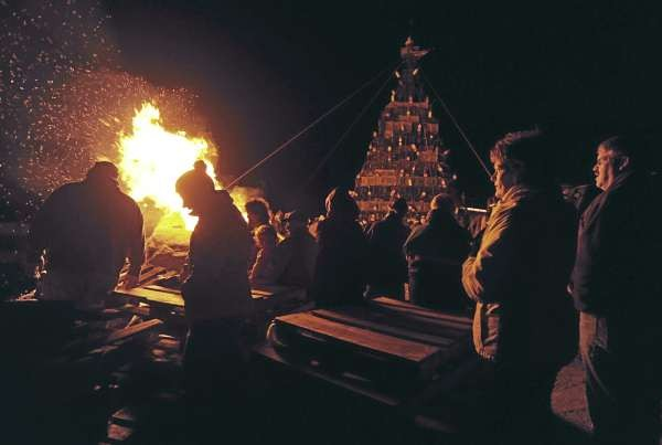 People gather on Beals Island on Sunday, November 28, 2010 to stand around a bonfire and listen to caroling before a huge x-mas tree constructed of lobster  traps and buoys was lighted. (Bangor Daily News/Kevin Bennett)
