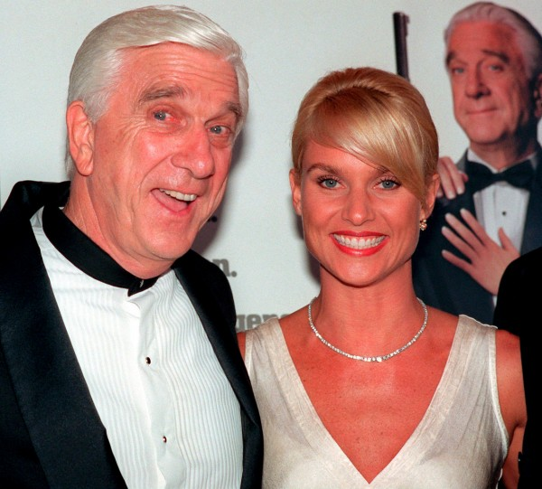 FILE - In this file  photo taken May 16, 1996, actors Leslie Nielsen, left, and Nicollette Sheridan arrive at the El Capitan Theatre in Los Angeles for the premiere of &quotSpy Hard.&quot The Canadian-born Nielsen, who went from drama to inspired bumbling as a hapless doctor in &quotAirplane!&quot and the accident-prone detective Frank Drebin in &quotThe Naked Gun&quot comedies, has died. He was 84. His agent John S. Kelly said Nielsen died Sunday, Nov. 28, 2010, at a hospital near his home in Florida where he was being treated for pneumonia. (AP Photo/Michael Caulfield, File)