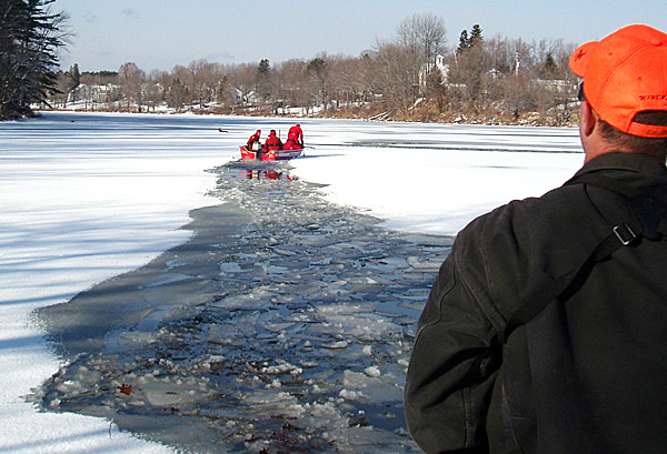 This is a photo of Dover-Foxcroft firefighters taken by Jeremy Kemp of the  rescue of deer who broke through the ice on the Piscataquis River in Dover-Foxcroft.  The deer were quite tired and probably would not have survived in the water much longer, said Kemp. (Photo courtesy of Jeremy Kemp)