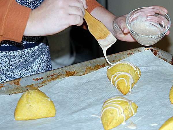 Pumpkin scones get a drizzle of glaze at Custom Cake Cafe in Fort Kent. (Photo by Julia Bayly)