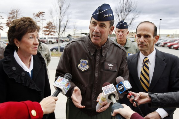 Gen. Raymond Johns (center), commander of the Air Mobility Command at Scott Air Force Base, Ill., speaks to reporters during a visit to the Maine National Guard's 101st Air Refueling Wing on Nov. 4, 2010, in Bangor, Maine. Sen. Susan Collins (left), R-Maine, and Gov. John Baldacci listen to Gen. Johns' remarks. The visit is part of an assessment that will determine the future of the so-called air bridge that provides in-air refueling for aircraft going to and coming from Europe, Afghanistan and Iraq.
