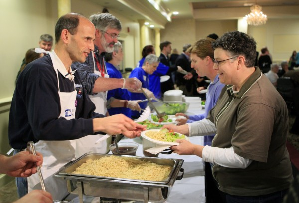 Maine Gov. John Baldacci (left) serves spaghetti at a fundraising event to benefit the Preble Street Resource Center, an agency that helps the homeless in Portland, in April 2010.