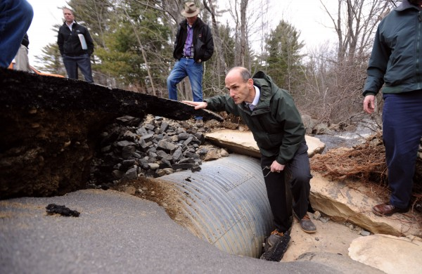 Governor John Baldacci checks a washed out culvert on Slab City Road in Lincolnville during his tour of storm damaged towns in the mid-coast area.  The governor made stops in several towns to speak with officials and looked at the damage caused by Monday night's storm.