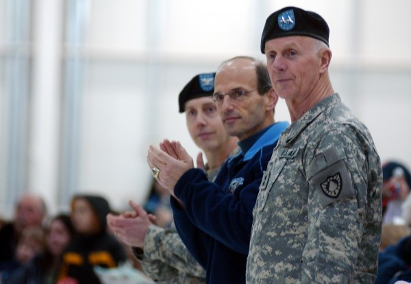 Maj. Gen. John W. Libby (right), adjutant general of the Maine National Guard, (right) Gov. John Baldacci watch as members of Charlie Company 1-126th Aviation Regiment file into the Army Aviation Support Facility in Bangor after completing a nine month deployment in Iraq on Jan. 1, 2009.