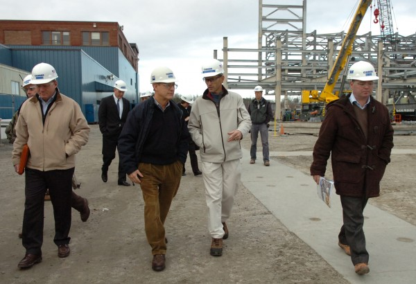 Cianbro CEO Pete Vigue (left of center) and Gov. John Baldacci (right of center) talk while leading a tour of their Brewer facility to Statoil's technical manager Knut Erik Steen (right) and asset manager Sjur Bratland (not pictured) on Nov. 17, 2009.