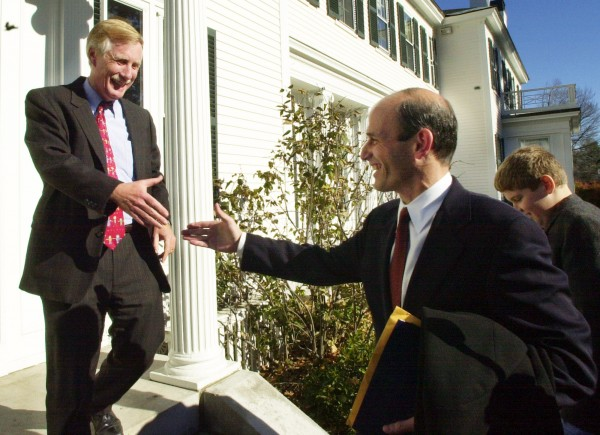 Gov. Angus King (left) welcomes Gov.-elect John Baldacci to the Blaine House, in Augusta in 2002.