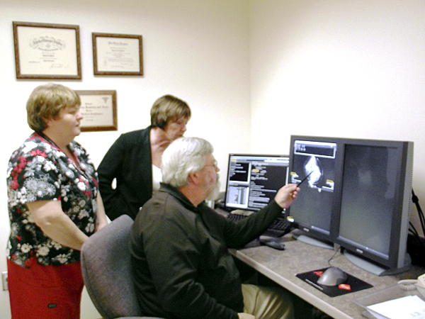 Dr. James Madix, center, the chief of radiology at Houlton Regional Hospital, points to an image on the screen on Wedneday, Nov. 3 as Elizabeth Dulin, left, the executive director of the Houlton Regional Health Services Foundation, and Sue McLaughlin, radiology department manager, look on. The foundation recently kicked off a campaign to raise $200,000 to upgrade the hospital so it is equipped with a digital mammography machine.
