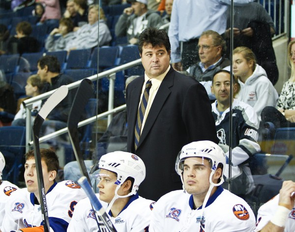 American Hockey League coach Jack Capuano on the bench with the Bridgeport Sound Tigers during a game against Worcester on Oct. 9, 2010. Capuano will serve as interim head coach for the New York Islanders.