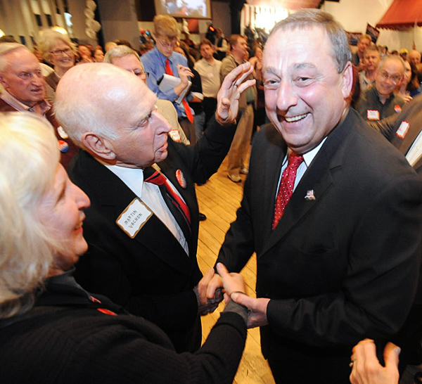 Paul LePage shakes hands with supporters at his election watch party in Waterville on Tuesday night.