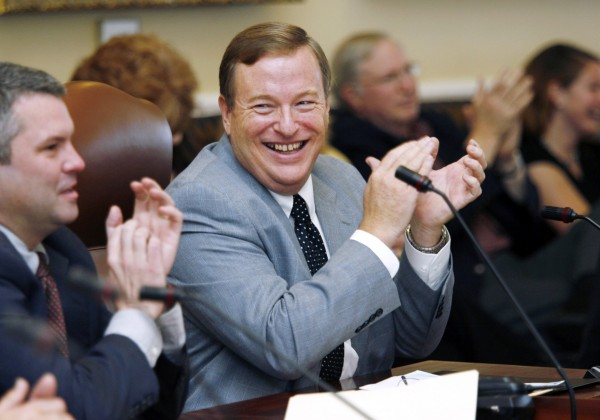 Newly-elected Maine Senate president Kevin Raye, of Perry, center, joined by newly-elected Majority Leader Sen. Jonathan Courtney, of York, left, applaud during Senate Republican caucus Friday, Nov. 5, 2010, in Augusta.