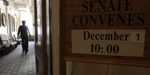 A sign outside the Senate at the State House in Augusta,  Maine, announces the anticipated convening of the new Legislature on Monday, Nov. 29, 2010. Maine's first Republican-majority Legislature in decades convenes this week.
