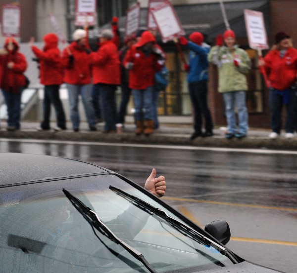 A passing motorist shows his support for the striking nurses at the Eastern Maine Medical Center in Bangor on Monday.