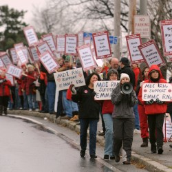 Nurses picket in the front of Eastern Maine Medical Center along State Street in Bangor Monday morning.