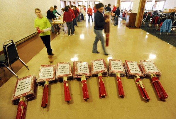 Nurses from Eastern Maine Medical Center in Bangor prepare picket signs in the basement of the Bangor Motor Inn on Saturday. The group has been locked out of the State Street hospital and will picket the campus on Monday.