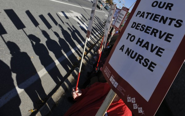 Off-duty registered nurses covered by the union contract at Eastern Maine Medical Cente and their supporters picketed in front of the hospital on State Street in Bangor in October after the nurses' contract expired.