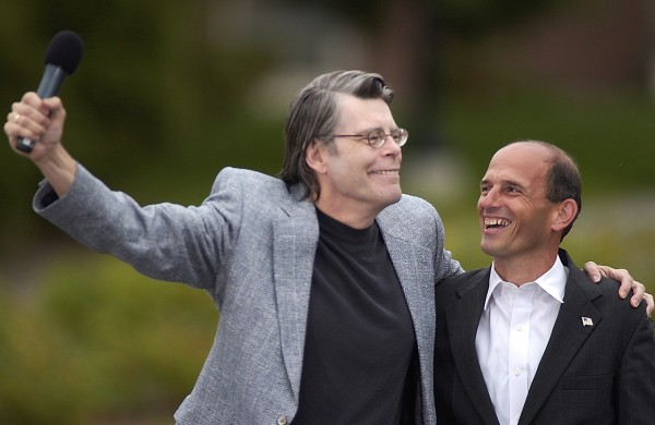 Author Stephen King and Gov. John Baldacci react to applause while stumping for the Kerry-Edwards presidential ticket at the University of Maine in Orono in 2004. &quotYou could write a horror book and it wouldn't compare to the administration in Washington right now,&quot said Baldacci.