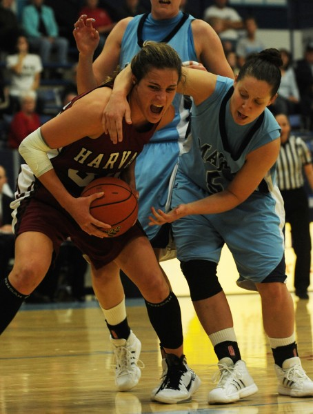 Maine's Tanna Ross, right, fouls Hartford's Emma Markley, left, during first-half action on Saturday. Nov. 13, 2010 at Orono. (Bangor Daily News/Kevin Bennett)