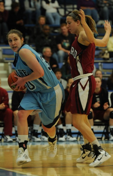Maine's Amber Smith, left, drives to the hoop against Hartford's Elle Hagedorn, left, during first-half action on Saturday. November 13, 2010 at Orono. (Bangor Daily News/Kevin Bennett)