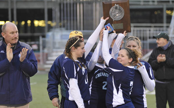 Van Buren' s girls soccer team holds up its runners-up plaque after Richmond beat the Crusaders 1-0 in the Class D girls state championship in Hampden Saturday. (Bangor Daily News/John Clarke Russ)