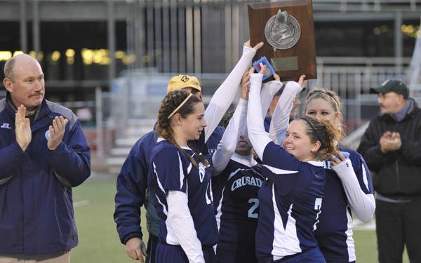 Van Buren' s girls soccer team holds up its runners-up plaque after Richmond beat the Crusaders 1-0 in the Class D girls state championship in Hampden Saturday. (Bangor Daily News/John Clarke Russ)