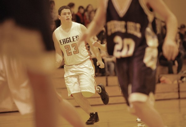 With the help of a prosthetic lower leg, Limestone Community School junior Zach Cote, 16,  runs downcourt during the Eagles' pre-season home game with Presque Isle on Monday.