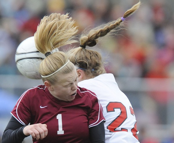 Bangor's Kim Jordan (1) collides with Scarborough's Tori Armishaw (22) for a header in the first half of the Class A state final in Falmouth, Saturday, Nov.6, 2010. Scarborough won 3-0. Bangor Daily News/Michael C. York