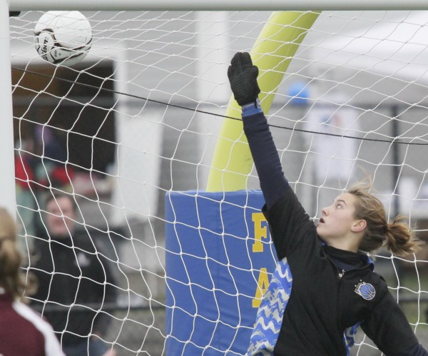Caribou goalkeeper Morgan Swan deflects a shot over the crossbar in the second half of the Class B state soccer final against Falmouth in Falmouth, Saturday, Nov. 6, 2010. Falmouth defeated Caribou 1-0.  Bangor Daily News/Michael C. York