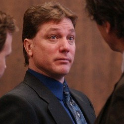 A teary-eyed Jeffrey Cookson (center) talks briefly with his attorneys, Steve Brochu (left) and William Maselli, after his sentencing. Cookson was sentenced to two consecutive life terms.