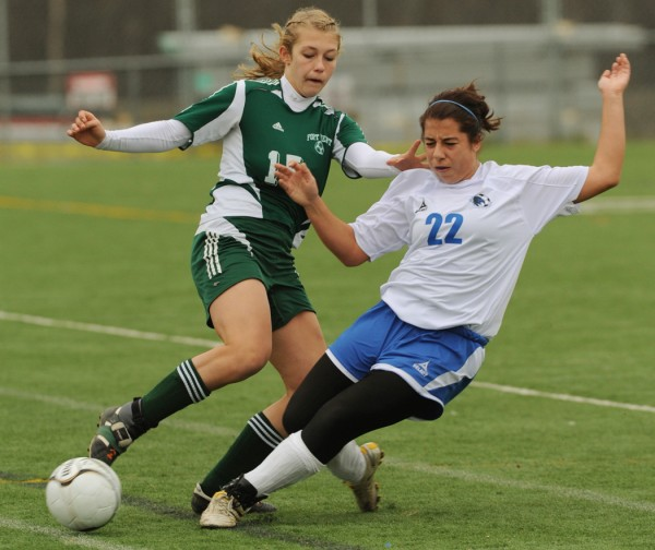 Sacopee's Michelle Pellegrino steals the ball from Fort Kent's Roxanne Pelletier during Class C state championship action on Saturday, November 6, 2010 at Haampden. Sacopee won 2-1 in overtime. (Bangor Daily News/Kevin Bennett)