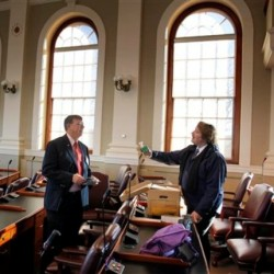 New State Rep. Frederick L. Wintle, R-Garland, left, gets a few words of advice from veteran State Rep. Herb Adams, D-Portland, at the State House, Friday, Nov. 19, 2010, in Augusta, Maine. Friday was orientation day for Maine's new class of state lawmakers. Wintle is one of the many new Republicans elected to give the GOP the majority. Adams was term limited out of office. (AP Photo/Robert F. Bukaty)