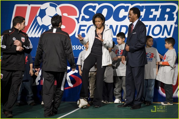 First Lady Michelle Obama plays soccer as she joins the US Soccer Foundation, Major League Soccer, Women's Professional Soccer, the National Alliance for Hispanic Health and others at a soccer clinic in Washington, DC, to highlight the Let's Move! campaign and the importance of children getting 60 minutes of active play each day.  (AFP  PHOTO/Jim WATSON)