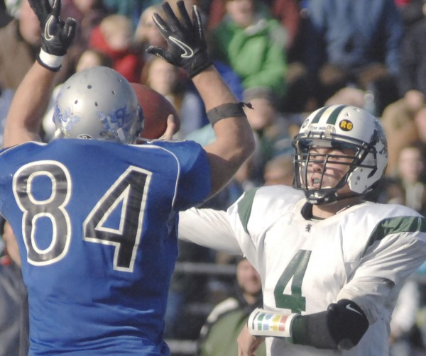 Mountain Valley's Christian Durland (84) puts a rush on Leavitt quarterback Jordan Hersom (4) in the fourth quarter of their state Class B football championship game in Portland, Saturday, Nov. 20, 2010. Mountain Valley won 20-0.