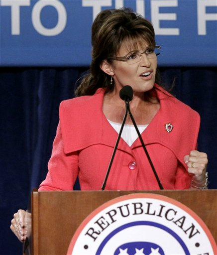 In this Oct. 23, 2010 file photo, former Alaska Gov. Sarah Palin speaks to supporters at a Republican National Committee rally in Orlando, Fla. (AP Photo/John Raoux, File)