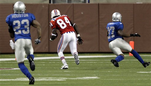 New England Patriots wide receiver Deion Branch (84) breaks away from Detroit Lions cornerback Alphonso Smith (27) and cornerback Chris Houston (23) for a 79-yard touchdown during the third quarter in an NFL football game, Thursday, Nov. 25, 2010, at Ford Field in Detroit. (AP Photo/Carlos Osorio)