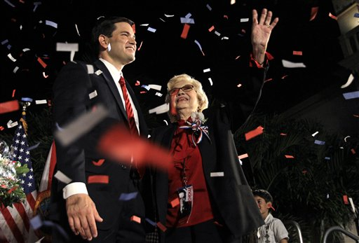 Republican Marco Rubio, left,  stands on the stage with his mother Oria Rubio, right, after winning his Senate bid Tuesday, Nov. 2, 2010 in Coral Gables, Fla. (AP Photo/Lynne Sladky)