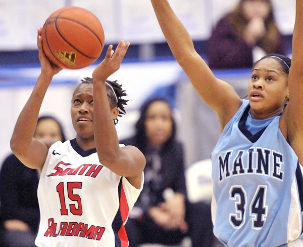 South Alabama's Britney Rutledge (15) drives for two points past Maine's Corinne Wellington (34) in the second half of their game in Orono Saturday.