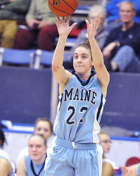 Maine's Samantha Wheeler (22) looks for the three-point shot and hits it with less than a minute to go in their game against South Alabama in Orono, Saturday.