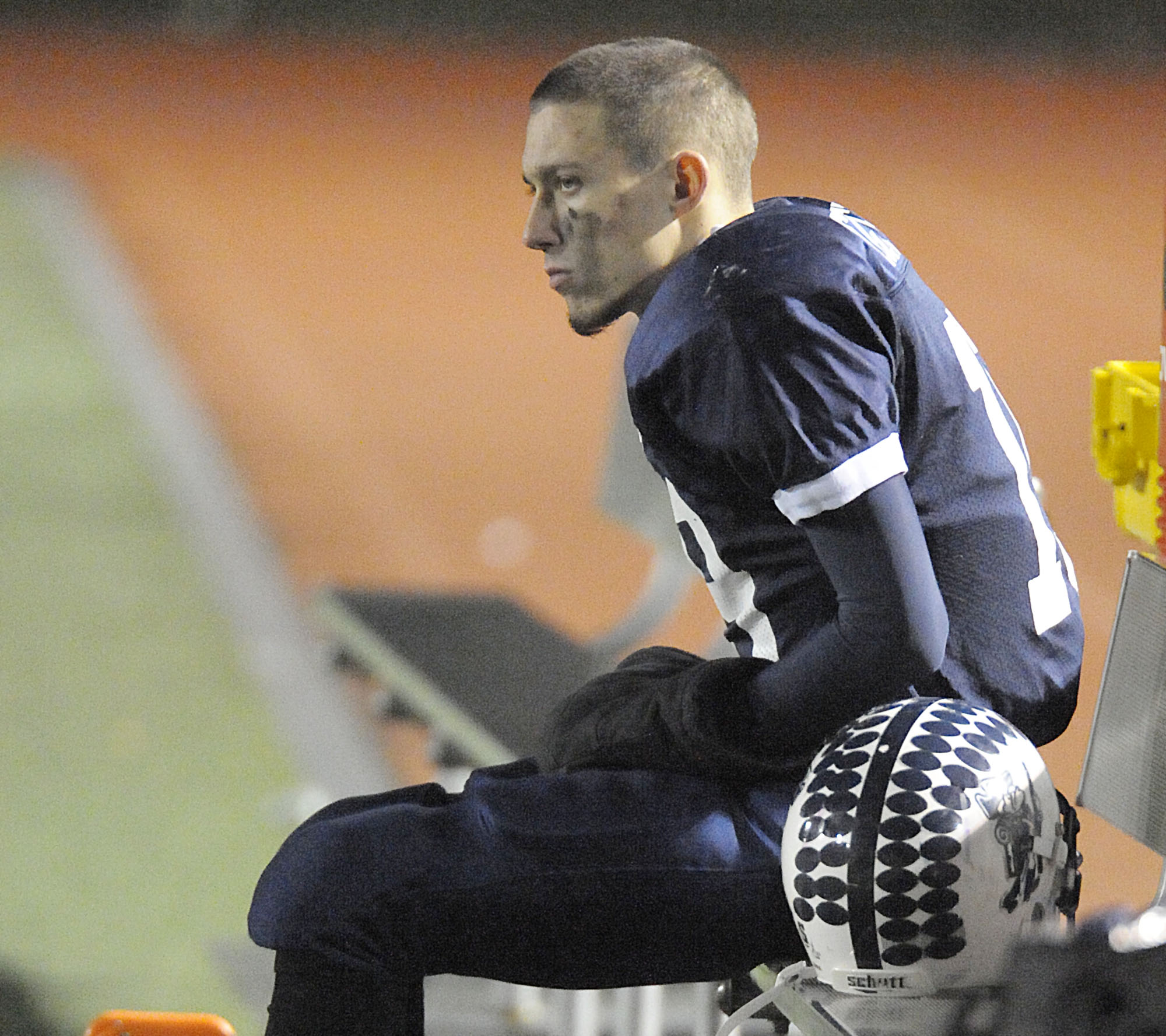 Stearns quarterback Jared McGreevy watches the final minutes of Saturday's state Class C football championship game from the bench after suffering a torn ligament injury in the first half against Yarmouth in Portland. The Yarmouth Clippers won 34-6.
