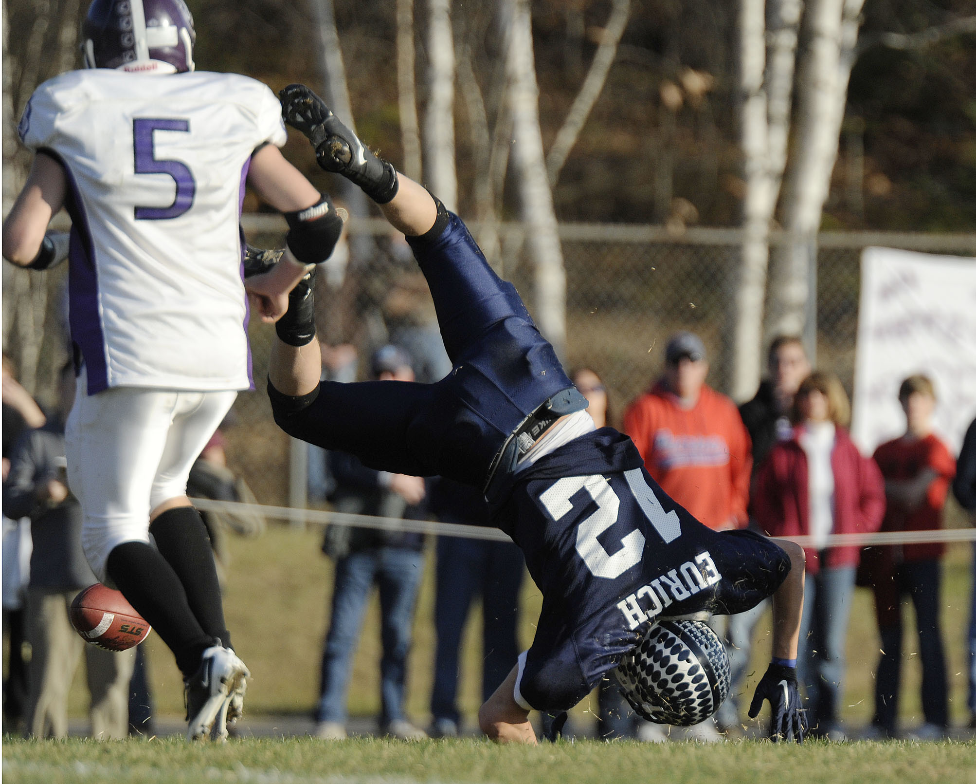 Stearns' running back Billy Eurich (12) gets upended as he can't come up with a pass in the second half of against John Bapst in the Eastern Maine Class C final in Millinocket, Saturday, Nov. 14, 2010. (BDN Photo by Michael C. York)