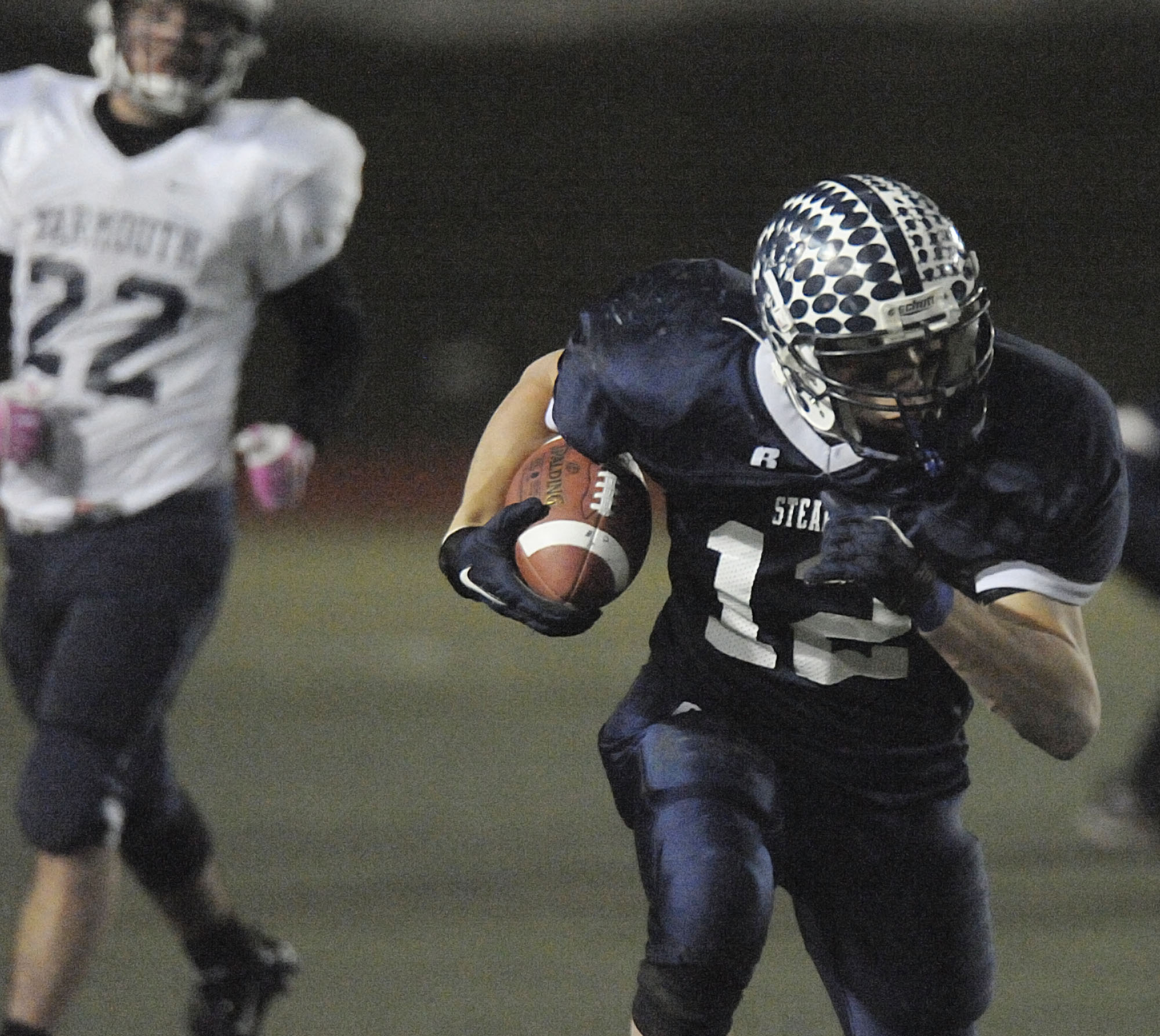Stearns running back Bill Eurich (12) carries the ball in the second half of Saturday's Class C state football title game against Yarmouth in Portland on Saturday. Yarmouth won 34-6.