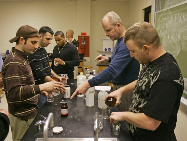 John Schupp, second from right, teaches a class of military veterans in the chemistry lab at Cleveland State University in Ohio. Schupp runs the university's Supportive Education for the Returning Veteran program that allows military veterans to take classes together to help them re-adjust to civilian life.