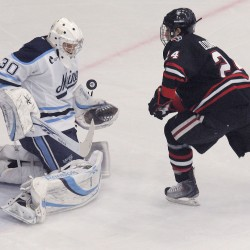 Maine goalie Dan Sullivan (30) makes a point-blank save on Northeastern's  Drew Daniels (24) in the first period of their game in Orono, Saturday, Nov. 13, 2010. (BDN Photo by Michael C. York)