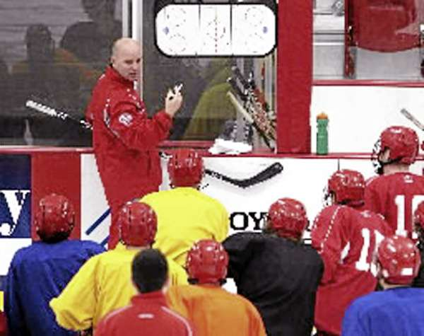 Former University of Maine All-American Jim Montgomery instructs his team during a recent practice. Montgomery is the head coach of the Dubuque Fighting Saints of the United States Hockey League. (Photo courtesy of Dubuque Telegraph Herald)