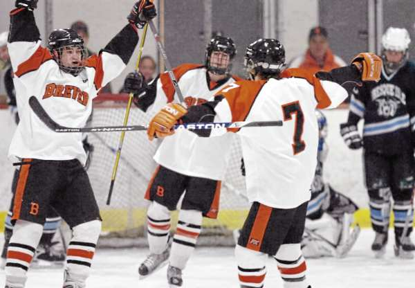 Brewer's Tyler White (far left) celebrates his goal against Presque Isle with teammates Evan Nadeau (center) and Jake Valley during a game last January. All three players have returned to help Brewer defends its Class B state title. (BDN File Photo)