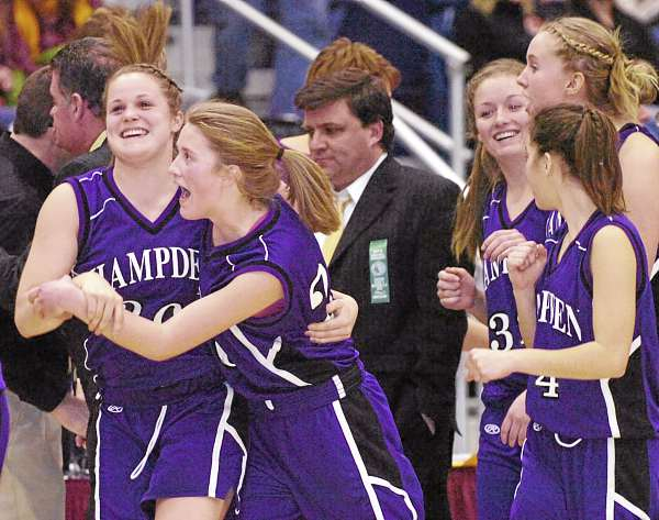 Hampden Academy's Ashley Danforth (left) and Helene Sherburne celebrate after the Broncos beat Edward Little in the Eastern Maine Class A girls basketball quarterfinals last season. With their entire roster back this winter, the Broncos are being pegged as one of the favorites in Class A this winter. (BDN File Photo)