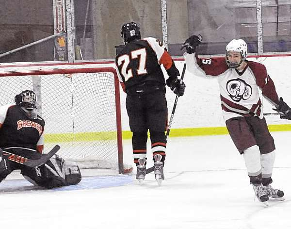 Phil Frost (right) of Bangor celebrates his second-period goal while Brewer goaltender Eric White (left) and teammate Chris Lopez react during a game last season. Frost, a senior, is one of the key players returning to lead the Rams this season. (BDN File Photo)